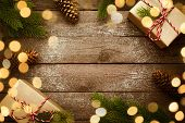 Christmas Border With Vintage Gifts And Decoration On Old Wooden Background. poster