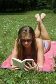 lady reading book in park
