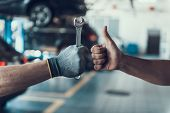 Close-up Thumb Up And Mechanics Hand With Tool. Automobile Master Wearing Gloves Showing Positive Ge poster