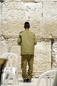 picture of tora  - israeli soldier praying at the wailing western wall - JPG