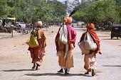 three wandering sadhus in hampi