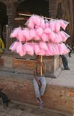BHAKTAPUR, NEPAL- APRIL 13 : A Nepali boy sells candy floss during Nepali New Year in Bhaktapur, Nepal on April 13, 2008.  Bhaktapur is located about 20 km east of Kathmandu.
