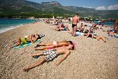 ZAGREB - JULY 29: Crowded beach of Zlatni Rat on June 05, 2009 in Bol, Croatia. Bol is one of the bu