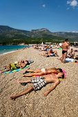ZAGREB - JULY 29: Crowded beach of Zlatni Rat on June 05, 2009 in Bol Croatia. Bol is one of the bus