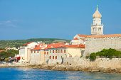 Seaview of fortifications and church of Krk village on Krk island in Croatia