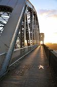 Sunset bridge sidewalk