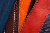 Colored Leather Straps. Background Of Leather Belts. poster