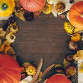 Thanksgiving Background With Autumn Dried Flowers, Pumpkins And Fall Leaves On The Old Wooden Backgr poster