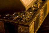 image of dirham  - A close up of wooden box filled with UAE Dirham coins - JPG