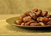 Plenty of ripped dates in a golden plate