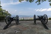Civil War Cannons - A Pair Of Cannons At A Scenic Overlook Above A City. poster