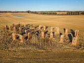 Drone Photo Of The Ruins Of An Old House In Countryside Fields In Small Countryside Village On A Sun poster