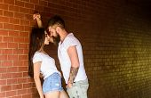 Desire And Temptation. Couple In Love Full Of Desire Brick Wall Background. Couple Find Place To Be  poster