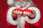 Christmas. Close Up Of Two Fists Of Santa Claus With A Red Bandage Wound On Them For Boxing. Kickbox poster