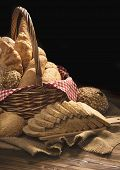 Composition With Bread And Rolls In Wicker Basket Isolated On Black Background poster