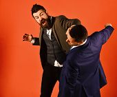 Business Fight Concept. Businessman With Raging Face Hits And Punches Opponent. poster