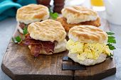 Breakfast Biscuits With Soft Scrambled Eggs, Bacon, Sausage And Chicken poster