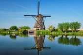 Netherlands rural lanscape with windmills at famous tourist site Kinderdijk in Holland poster