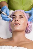 Portrait Of Woman Getting Rf-lifting. Rf Lifting Procedure In A Beauty Parlour poster