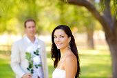 stock photo of married couple  - couple just married with man holding flowers in hand - JPG