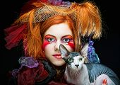 yong princess with cat. creative fantasy make-up.