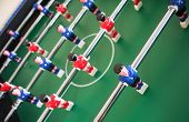 Soccer table game with red and blue players