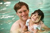 picture of swimming pool family  - Father and toddler boy swimming in pool - JPG
