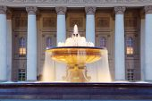 Fountain with illumination near Bolshoi Theatre (Great Theater) at evening in Moscow, Russia.