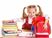 Happy little girl with school supplies and book. Isolated.