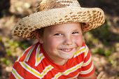 Happy Boy In A Straw Hat