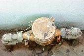 foto of vacuum pump  - Old water meter on the ground of house - JPG