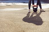 foto of kettlebell  - Shadow of a fitness crossfit woman lifting a kettlebell - JPG