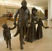 stock photo of martha  - Life sized bronze sculptures of George and Martha Washington and two grandchildren Nelly and Washy at the Ford Orientation Center at Mount Vernon Washington DC - JPG