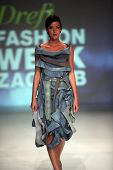 ZAGREB, CROATIA - May 11: Fashion model wears clothes made by Ana Kujundzic on