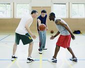 stock photo of indoor games  - Jump ball in basketball game - JPG
