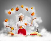 juggler female asian cook against color background