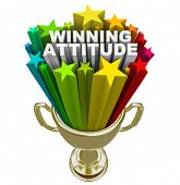 The words Winning Attitude in a gold trophy with colorful stars and fireworks shooting around it to