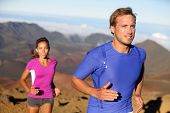 Runners trail running athletes. Young fitness runner couple training trail running cross-country run