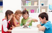 stock photo of schoolboys  - Kids repeating and observing a science lab project at home  - JPG