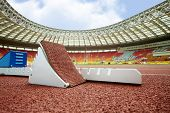 MOSCOW - JUN 11: Starting blocks on race track for steeplechase at Grand Sports Arena of Luzhniki OC