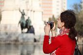 MADRID - MARCH 9: Woman photographs monument to Don Quixote and Sancho Panza, on March 9 2012 in Mad