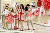 Group of dressed female mannequins in clothing store