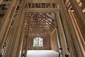 stock photo of stud  - Bonus Room Wood Studs Framing in Upstairs of New Home Construction - JPG