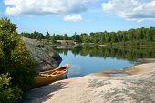Canoe Beside Lake