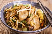 stir fried noodles with chicken and vegetables