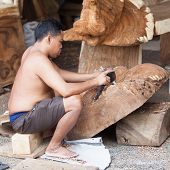Working Balinese Carver In Workshop