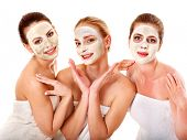 stock photo of mask  - Group women with  facial mask in beauty spa - JPG