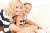 picture of mother and daughter with laptop