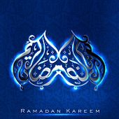 Arabic Islamic calligraphy of shiny text Ramadan Kareem or Ramazan Kareem on blue background.