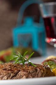 stock photo of flambeau  - closeup of a steak with a rosemary leaf  - JPG